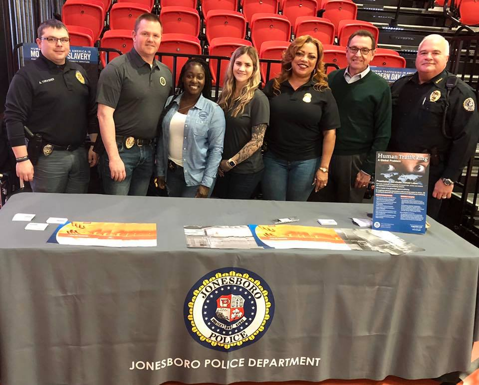 Law Enforcement agents along with Mayor Perrin and Chief Rick Elliott posed together at info table o