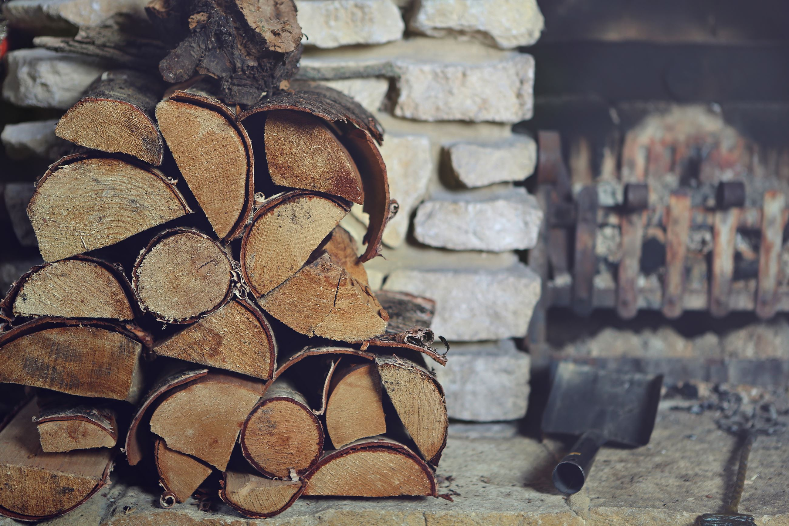 Firewood sitting on a fire place