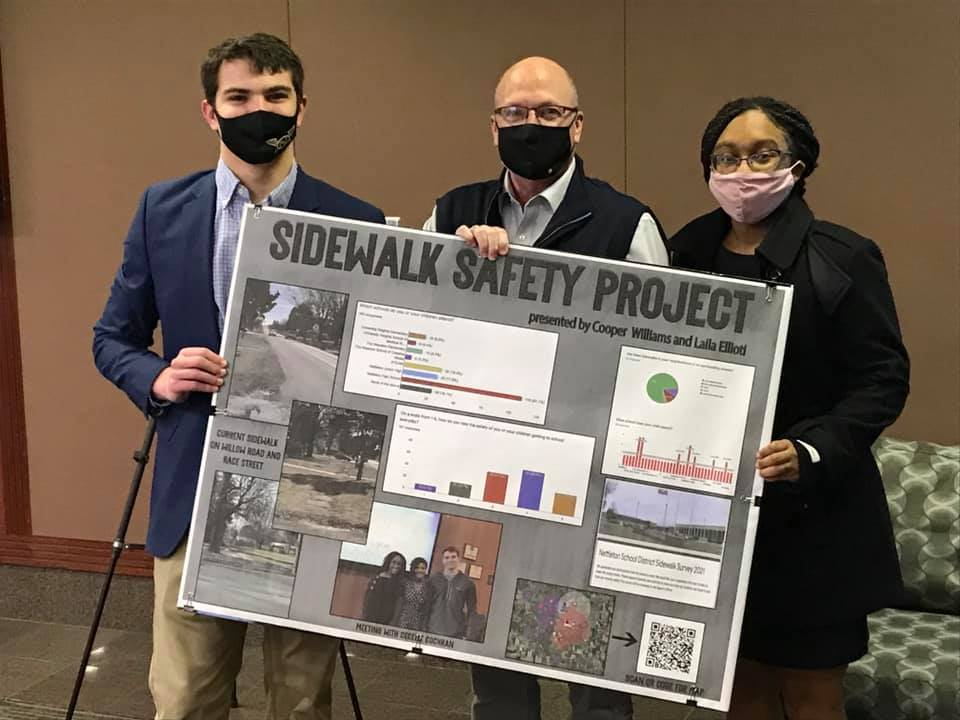 Mayor Copenhaver with Laila Eliotti and Cooper Williams holding their Sidewalk Safety project board
