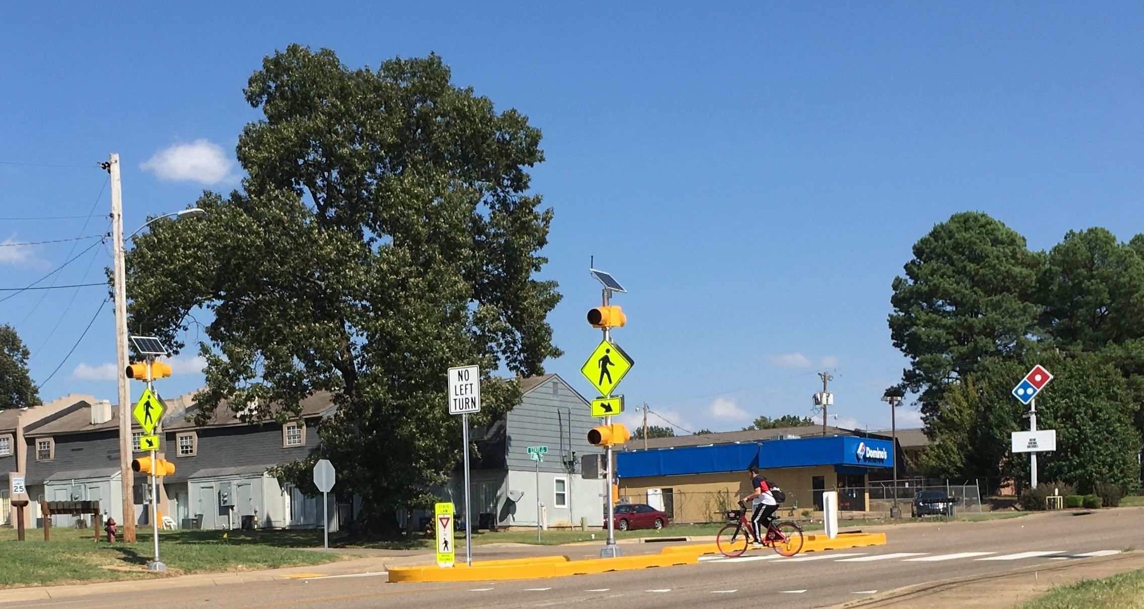 Cyclist at Highway 91 temporary pedestrian crossing Opens in new window